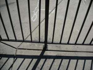 concrete mounted wrought iron view fence