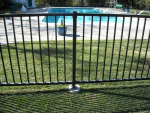 dirt mounted wrought iron view fence