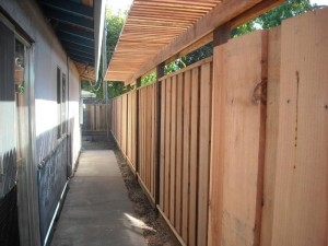 six foot redwood fence with inline shade trellis