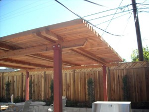 freestanding redwood patio cover with steel posts